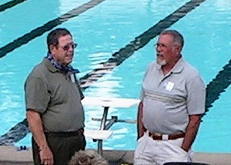 Bob Davis and Rex Zickefoose talk by the pool